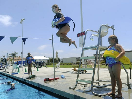 Katie Wicks, of Ventura, enters the water from the tower as she practices rescues during the junior lifeguard academy at the Ventura Aquatic Center in this Star file photo.