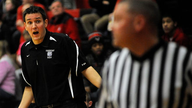 Green Bay West coach Steven Sickler reacts to a Wildcats foul during their Fox River Classic Conference boys basketball game against Manitowoc Lincoln on Friday, Jan. 23, 2015.