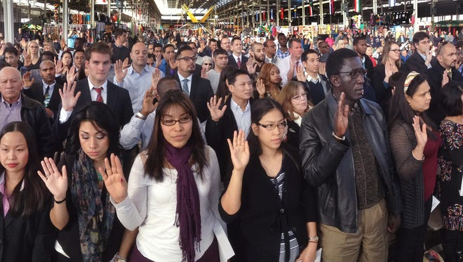 Immigrants -- 192 from 65 countries -- take the oath of citizenship to become U.S. citizens at a naturalization ceremony in Indianapolis on Friday, Nov. 21, 2014.