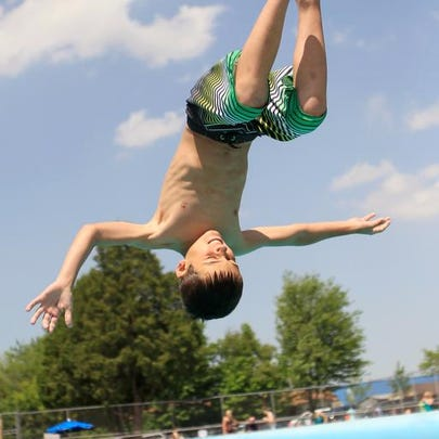 Laura Schmitt/Marshfield News-Herald Emmett Meissner, 9, of Chili, does a flip off the board at Hefko Pool in Marshfield on Wednesday, June 8, 2011.