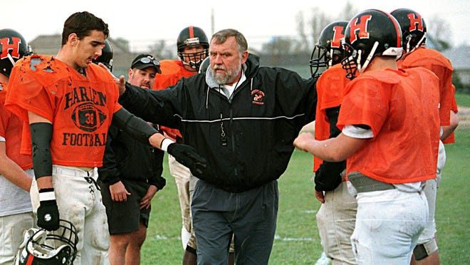 Former Rockford East and University of Wisconsin player Jerry Stalcup, shown working with Harlem players when he was the Huskies' defensive coordinator, not only is one of Rockford's 25 greatest football players but had an influence on many others on the list.
