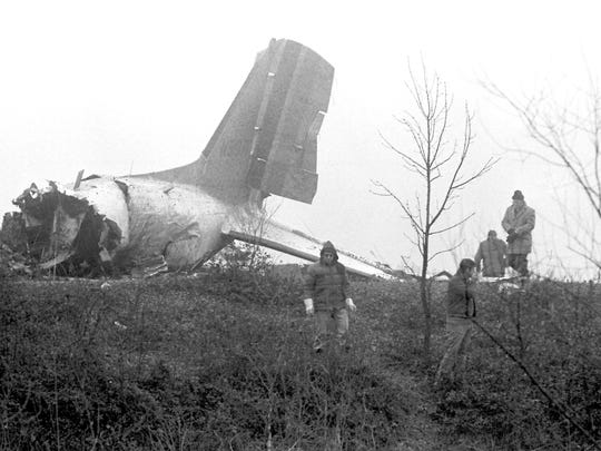 The wreckage of chartered airliner N51071, a DC-3 lies broken and twisted on an Evansville, Indiana, hillside on Dec. 14, 1977. The plane crashed in the evening of Dec. 13, 1977 killing all 29 passengers, including the University of Evansville basketball team.