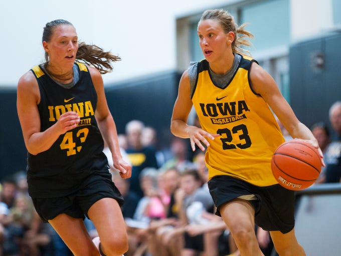 Iowa forward Amanda Ollinger covers Iowa forward Logan