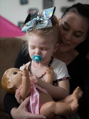 Meichelle Hunley holds Ava, 2. Hunley adopted Ava after