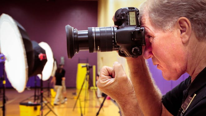 Alan Loveless, owner photographer of Loveless Fine Photography, takes a photo of a student Friday, Aug. 19, 2016, at Smyrna High School.
