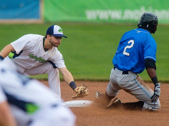 The Lake Monsters' Ryan Gridley, left, tags out the Hudson Valley Renegades' Vidal Brujan at Centennial Field in Burlington on Friday, July 7, 2017.