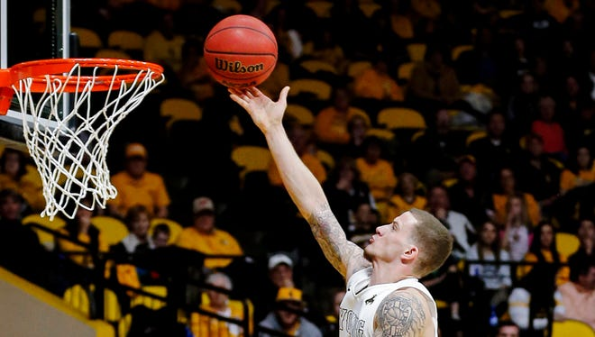 Wyoming's Josh Adams lays the ball in for two of his 28 points Saturday in the Cowboys' 83-76 win over CSU in Laramie, Wyo.