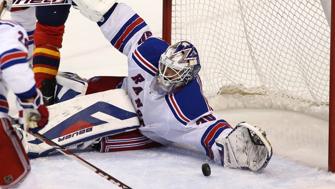 Henrik Lundqvist makes one of his 19 saves for the Rangers.