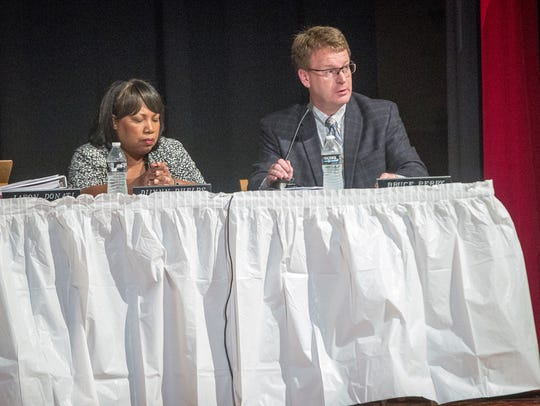 Chief Financial Officer Bruce Perry (right) speaks