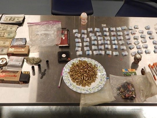 Drugs, weapons, ammunition and money were recovered from a Marydel-area home.
