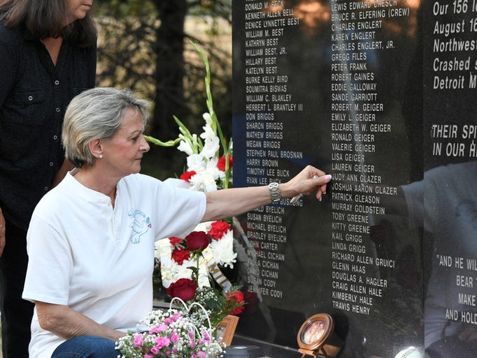 Mourners gather for a memorial in remembrance of the