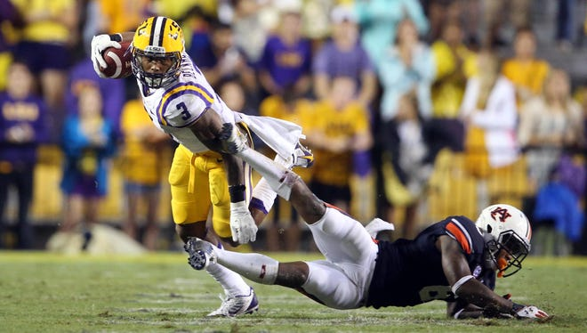 LSU wide receiver Odell Beckham (3) jukes Auburn defensive back Jonathon Mincy (6) in the second half of a 35-21 victory on Sept. 21 at Tiger Stadium.