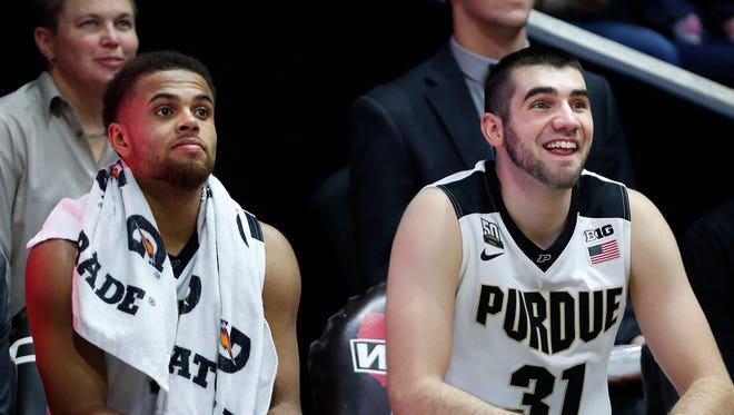 Dakota Mathias and P.J. Thompson of Purdue half a laugh from the bench as they watch their teammate finish out Fairfield Saturday, November 18, 2017, at Mackey Arena. Purdue defeated Fairfield 106-64.
