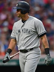 New York Yankees' Gary Sanchez walks to the dugout after striking out in the fourth inning of a baseball game against the Cleveland Indians, Thursday, Aug. 3, 2017, in Cleveland.