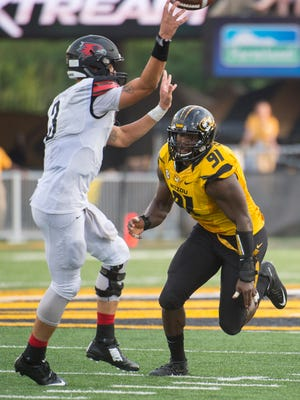 Missouri's Charles Harris, right, moves in on Southeast Missouri State quarterback Tay Bender.