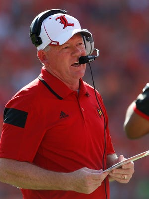CLEMSON, SC - OCTOBER 11: Head coach Bobby Petrino of the Louisville Cardinals calls a play during the game against the Clemson Tigers at Memorial Stadium on October 11, 2014 in Clemson, South Carolina. (Photo by Tyler Smith/Getty Images)