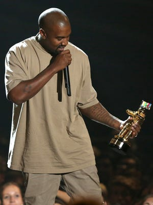 Kanye West accepts the video vanguard award at the MTV Video Music Awards at the Microsoft Theater on Sunday, Aug. 30, 2015, in Los Angeles.