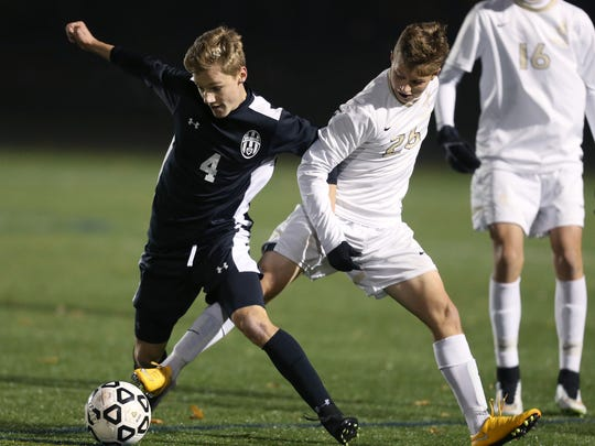 HF-L's David Goetz (4) and John Mozrall (26) try to control the ball.