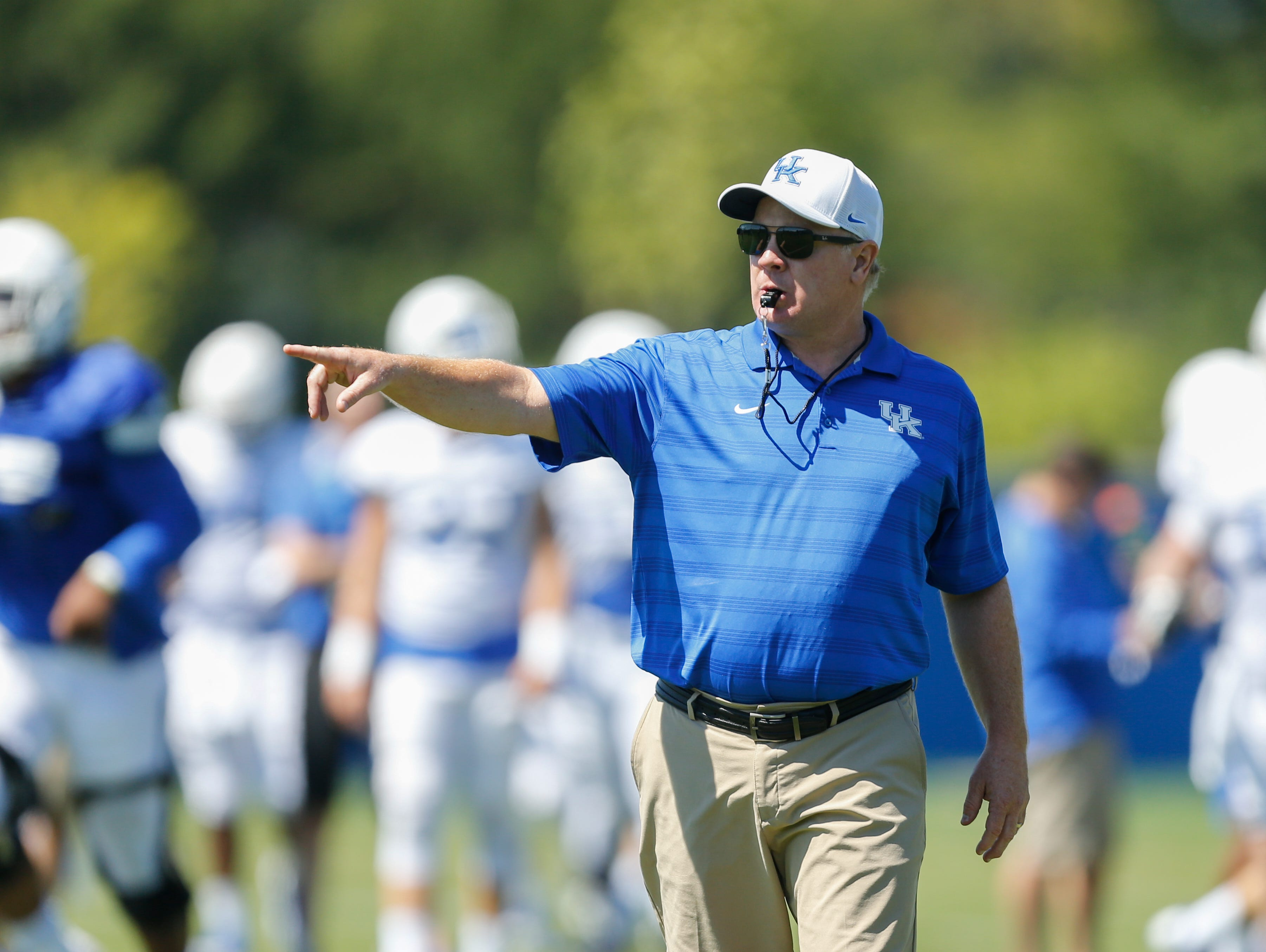 UK head coach Mark Stoops yells a command at the team during UK Football Fan Day open practice at Joe Craft Football Training Facility in Lexington, Ky., on Saturday, August 5, 2017.