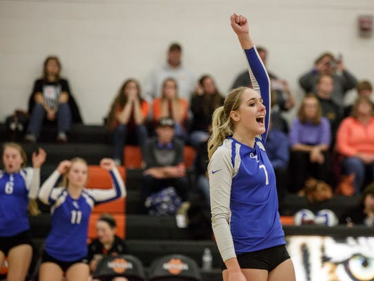 Croswell-Lexington's Lexie Davidson celebrates during