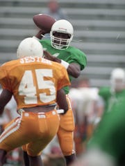 Quarterback Jerry Colquitt winds up to pass during the first scrimmage at Neyland Stadium on Aug. 20, 1994. Photo by Andrew Cutraro
