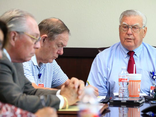 Nueces County Judge Loyd Neal talks with members of