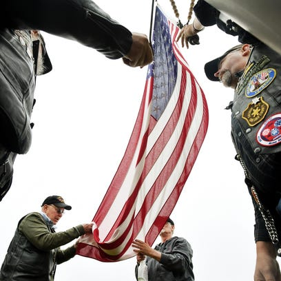 'Labor of love' keeps flags whole for fallen