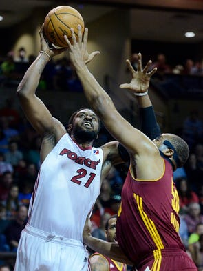 The Skyforce's Henry Walker tries to shoot over Canton Charge's Arinze Onuaku in Saturday night's playoff game at the Sanford Pentagon, April 12, 2014.