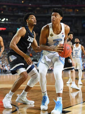 UNC forward Isaiah Hicks (4) drives to the basket against Gonzaga Bulldogs forward Johnathan Williams (3) in the first half in the championship game of the 2017 NCAA Men's Final Four at University of Phoenix Stadium.