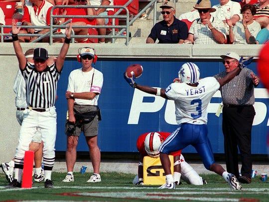 Craig Yeast scores a touchdown against Louisville in