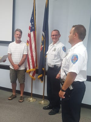 Jeremy Rasch, at right, is sworn in as Deputy Police Chief.