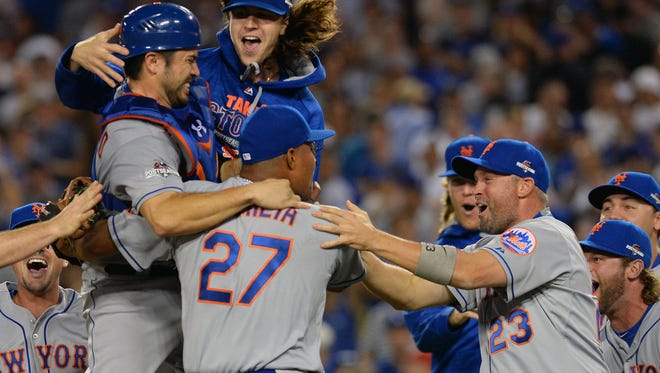 New York Mets starting pitcher Jacob deGrom (48) celebrates the 3-2 victory against Los Angeles Dodgers with teammates in Game 5 of NLDS at Dodger Stadium.