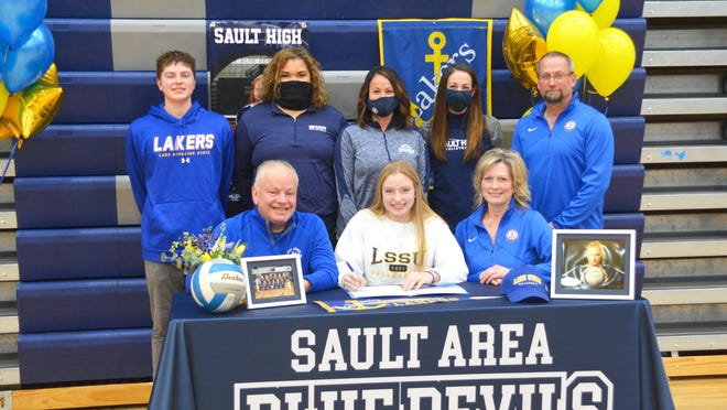 Jordyn Haller, front row center, has signed to attend and play volleyball at Lake Superior State University. She was joined by her parents, brother and coaches to celebrate the signing recently at the Sault High gym. Pictured front row from left are Tony Haller, Jordyn Haller and Kristine Salo; back row, from left: Dominic Haller, Sault JV coach Stephanie Lynn, Sault assistant coach Lisa Moran and Sault head coach Jessica Murawski, and Terin Salo.