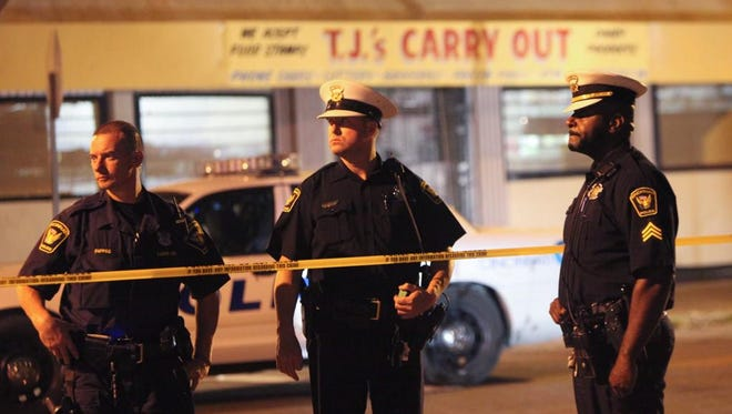 Police investigate the scene of a multiple shooting in Evanston.