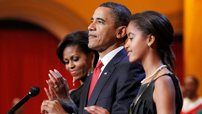 The first family, from left, Sasha Obama, first lady Michelle Obama, President Barack Obama, and Malia Obama.