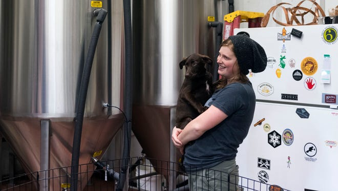 Jordan Skeen, head brewer at Clinch River Brewery in Norris, TN with her pup Bear during a meeting of the Knoxville chapter of the Pink Boots Society on Sunday, February 11, 2018.