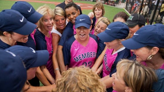 U.S. Representative Martha Roby, R-Ala., center, leads her teammates in a pre-game huddle in the Congressional Women's Softball Game. The annual game benefits the Young Survival Coalition, which helps those who have battled breast cancer through the challenges of recovery.