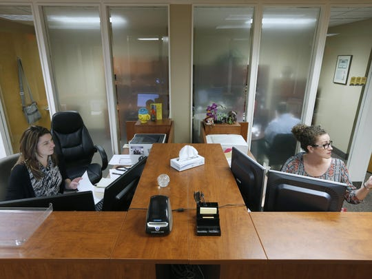 Senior sales associate Victoria Flugel and client service associate Shannon Sullivan at work at Brighton Securities.