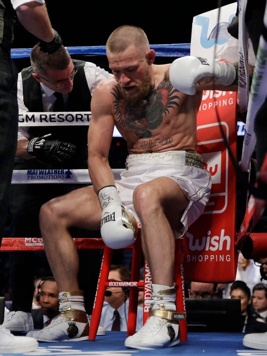 Conor McGregor sits in his corner between rounds in a super welterweight boxing match against Floyd Mayweather Jr., Saturday, Aug. 26, 2017, in Las Vegas. (AP Photo/Isaac Brekken)