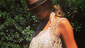 Stacy Keibler shows off her baby bump in a bikini and woven cover-up in this recent Instagram photo.