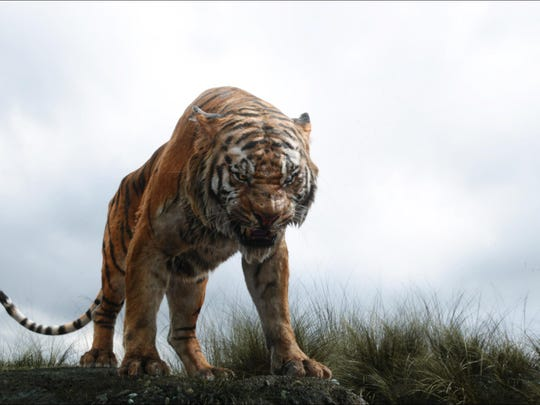 "Shere Khan the tiger, voiced by Idris Elba, appears in a scene from ""The Jungle Book."" The movie took the top spot at the box office for its second weekend, far outrunning second-place ""The Huntsman: Winters' War."""