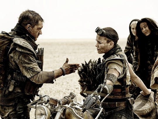 Tom Hardy, as Max Rockatansky, and Charlize Theron,
