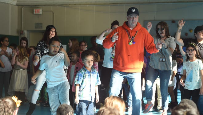 Brian Archer, right, principal at Sargent Elementary School in Beacon, dances with students as part of an event to raise money for the Leukemia & Lymphoma Society.