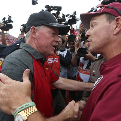 FSU Head Coach Jimbo Fisher meets Louisville's Bobby