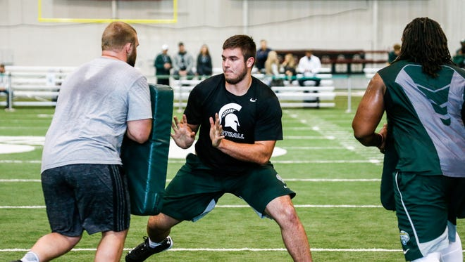 Michigan State's defensive lineman Jack Conklin runs defensive drills on Pro Day at the Duffy Daugherty Football Building in East Lansing. on Wednesday, March 16, 2016.