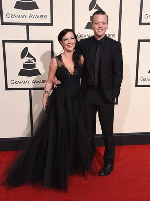Jason Isbell, right, and Amanda Shires arrive at the 58th annual Grammy Awards at the Staples Center on Monday, Feb. 15, 2016, in Los Angeles. (Photo by Jordan Strauss/Invision/AP)