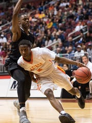 Corona del Sol's Saben Lee (2) drives the baseline against Cesar Chavez's Malik Porter (3) during their 6A Conference semifinals game on Thursday, Feb. 23, 2017, at Gila River Arena in Glendale, Ariz.