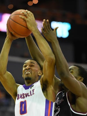 University of Evansville's Ryan Taylor (0) looks to shoot past defense from North Carolina Central's Raasean Davis (32) as the University of Evansville play North Carolina Central for Kids Day at the Evansville Ford Center Monday, November 13, 2017.