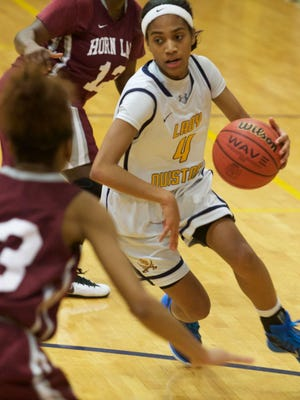 Olive Branch's Mahogany Vaught (4) drives to the basket in Friday's game against Horn Lake. Vaught finished with 7 points, including a big 3-pointer that sparked an 8-0 run.