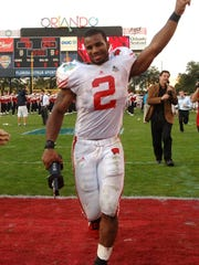 Wisconsin running back Brian Calhoun acknowledges the fans after beating Auburn in the Capital One Bowl football game in Orlando, Fla., Monday, Jan. 2, 2006.